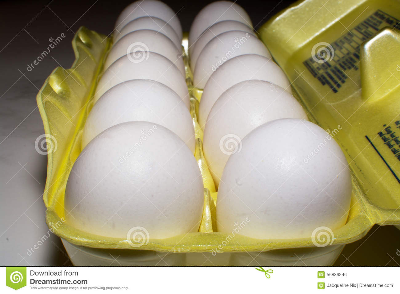 Dozen Eggs In A Yellow Carton Stock Photo - Image: 56836246