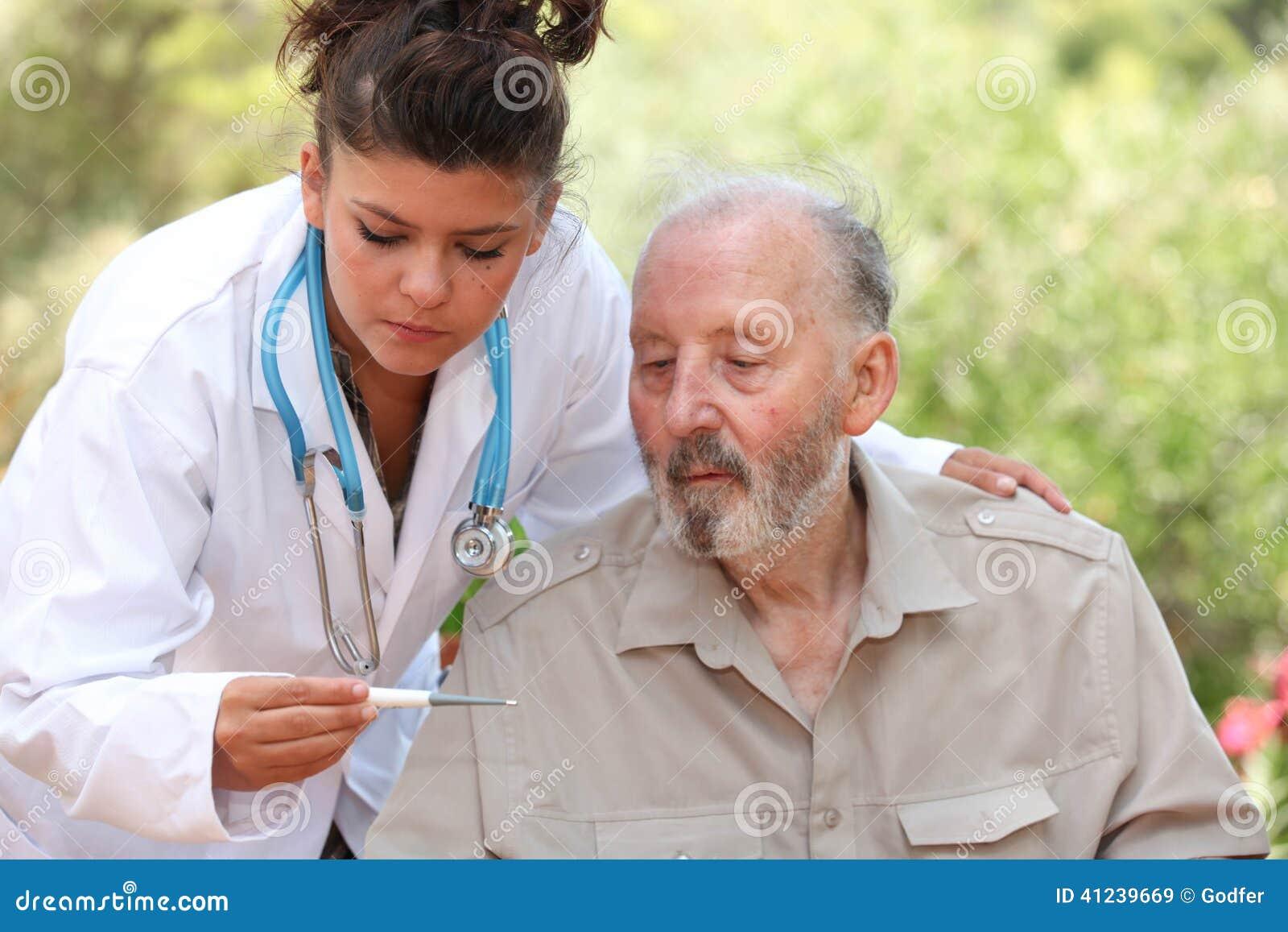 Dr. termômetro da leitura do homem superior