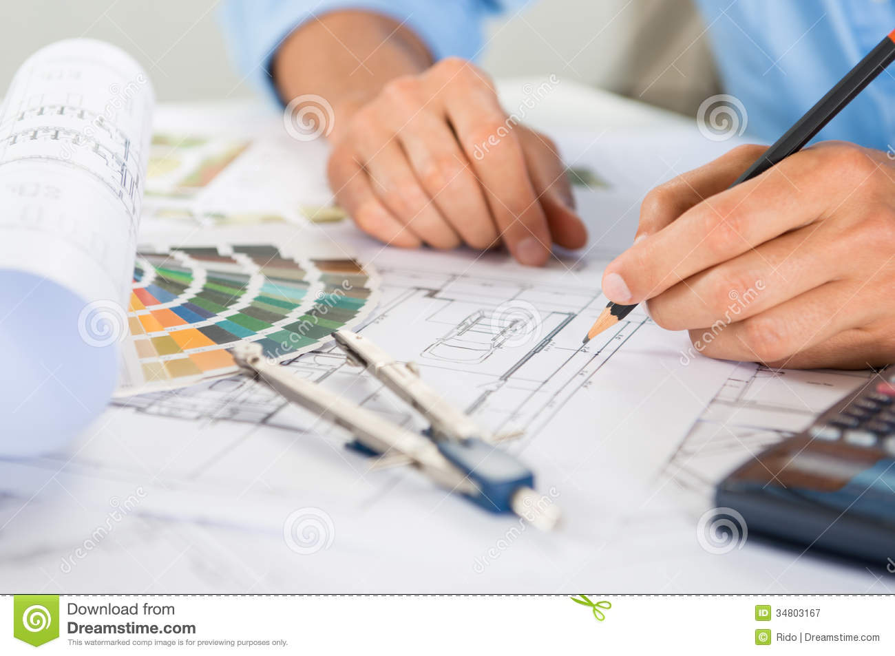 Draftsman drawing blueprints royalty free stock for Blueprint estimator