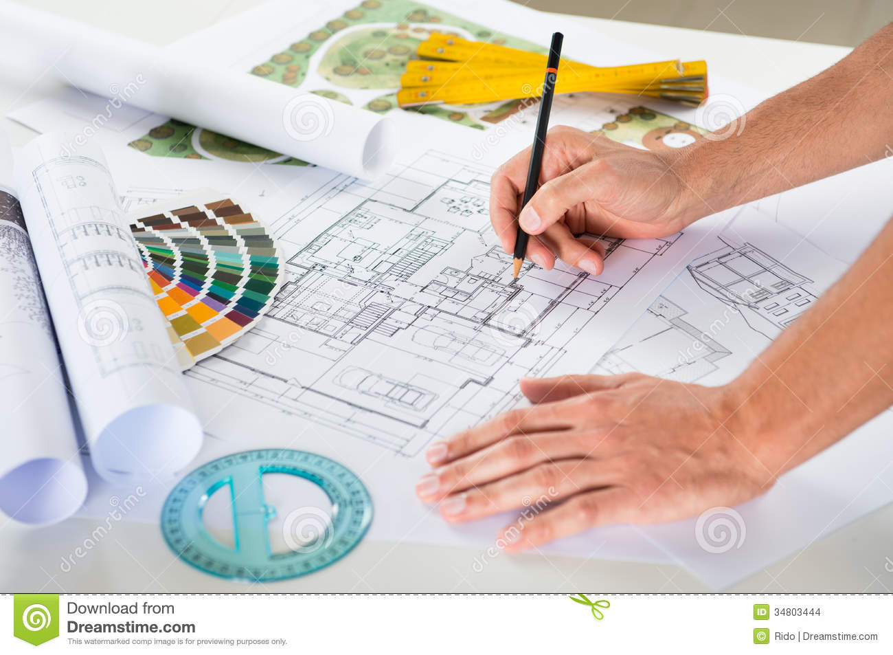 Architectural Drawing Blueprint draftsman drawing plan on blueprint stock images - image: 34803444