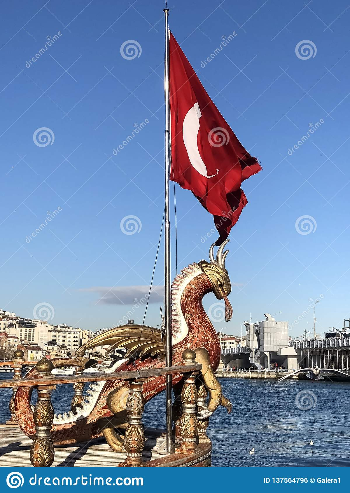 Dragon and flag of Turkey in port of Istanbul