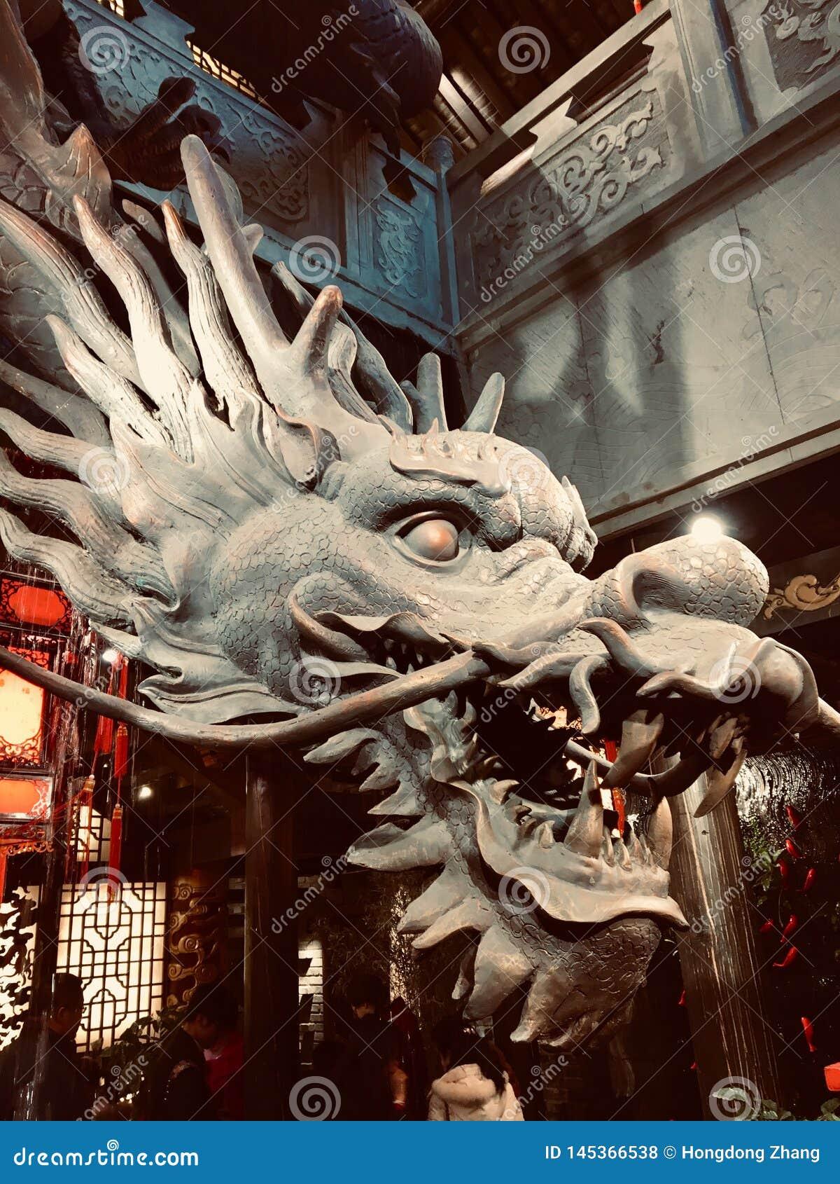 Chinese dragon head wood carving closeup