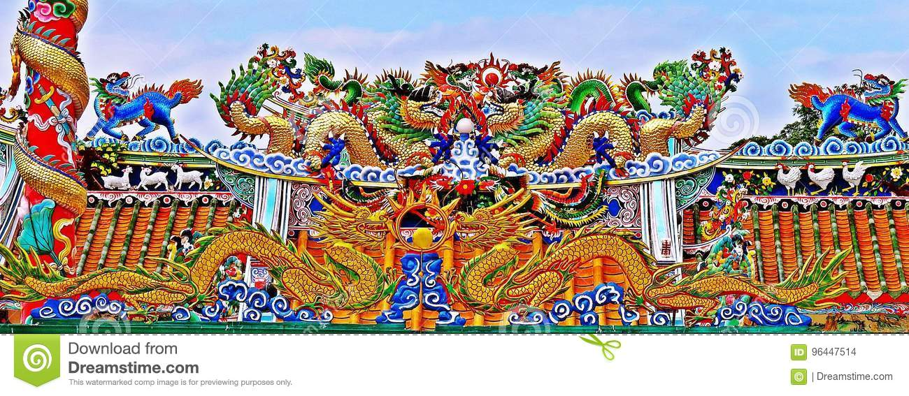 Dragon statue flying Chinese temple roof in Thailand