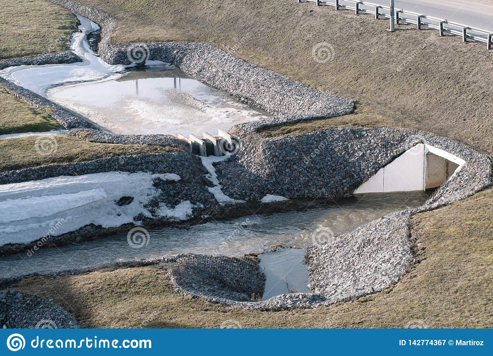 Drainage system for the highway reinforced with stones