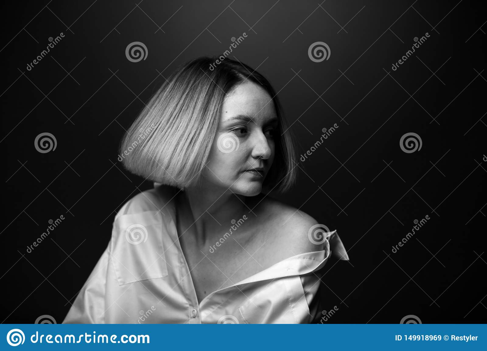 Dramatic black and white portrait of a beautiful woman on a dark