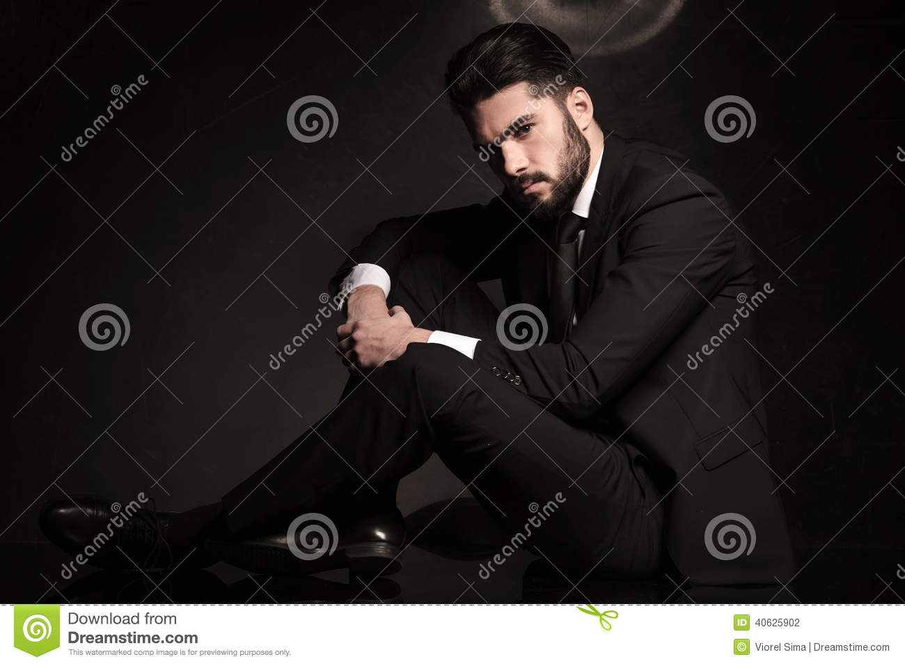 Dramatic business man sitting on the floor