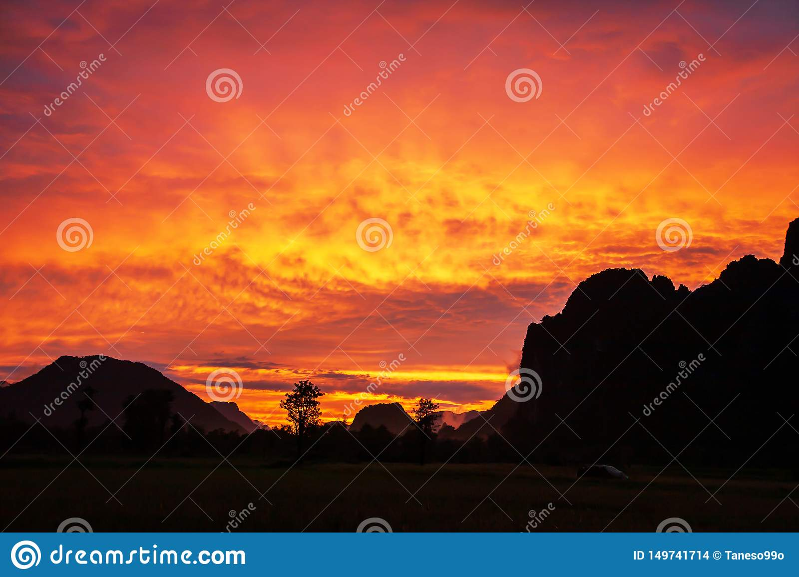 Dramatic clouds above a limestone mountain range, colorful ripple clouds on sunset sky, fantastic winter scene in North Laos