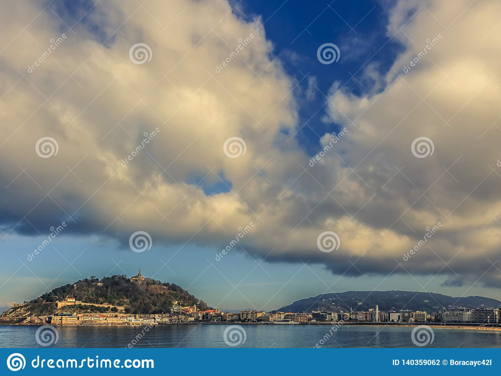 Dramatic clouds above San Sebastian in the late afternoon