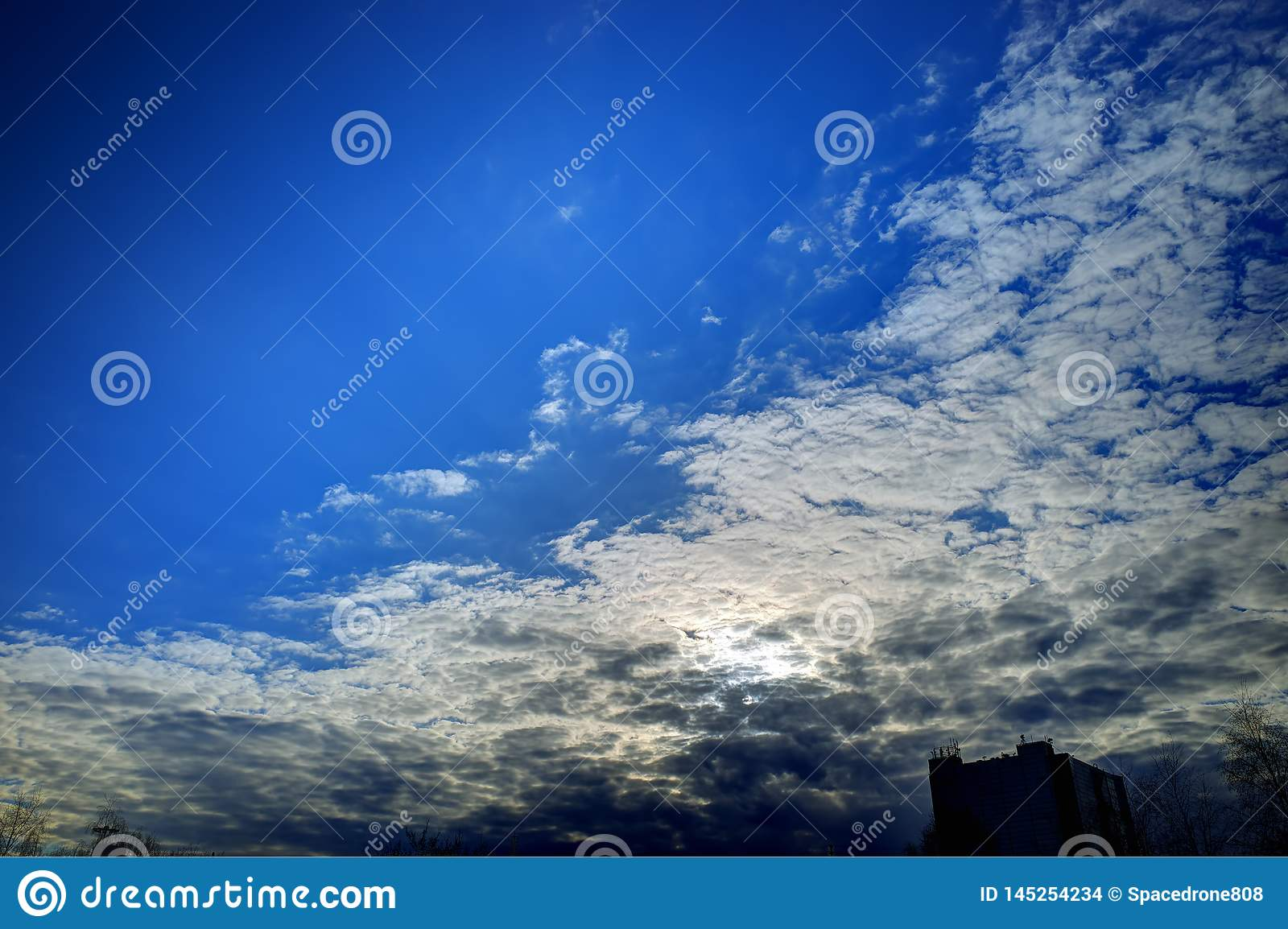 Dramatic Clouds Over The City Skyline Background Hd Stock
