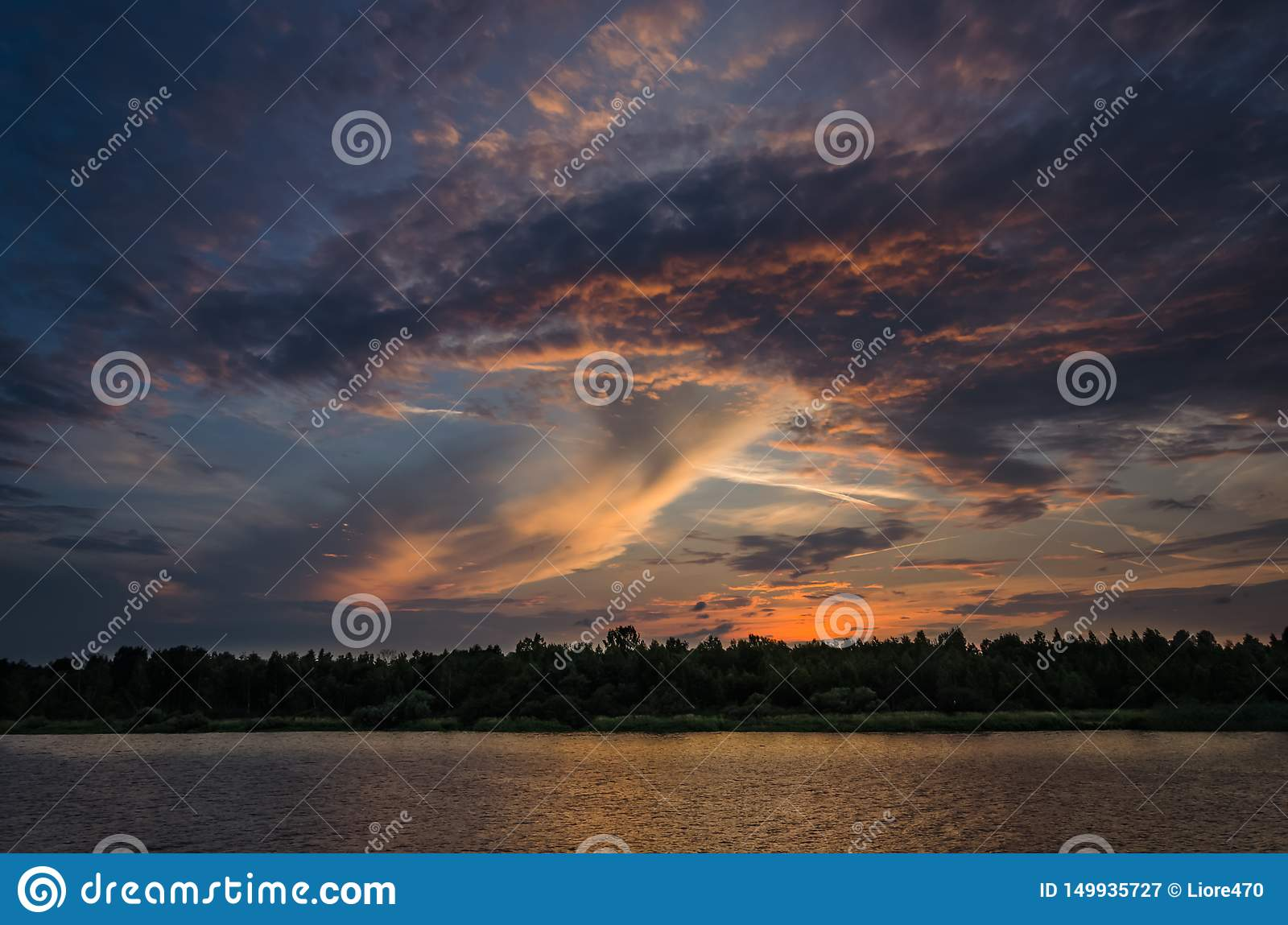 Dramatic clouds over water during sunset