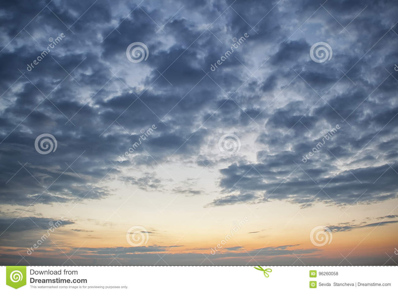 Dramatic dark cloudy sky over sea, natural photo background. Dark storm clouds background