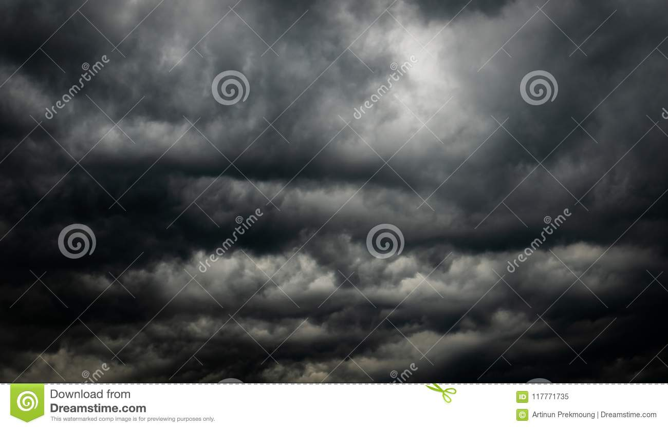 Dramatic dark sky and clouds. Cloudy sky background. Black sky before thunder storm and rain. Background for death, sad, grieving