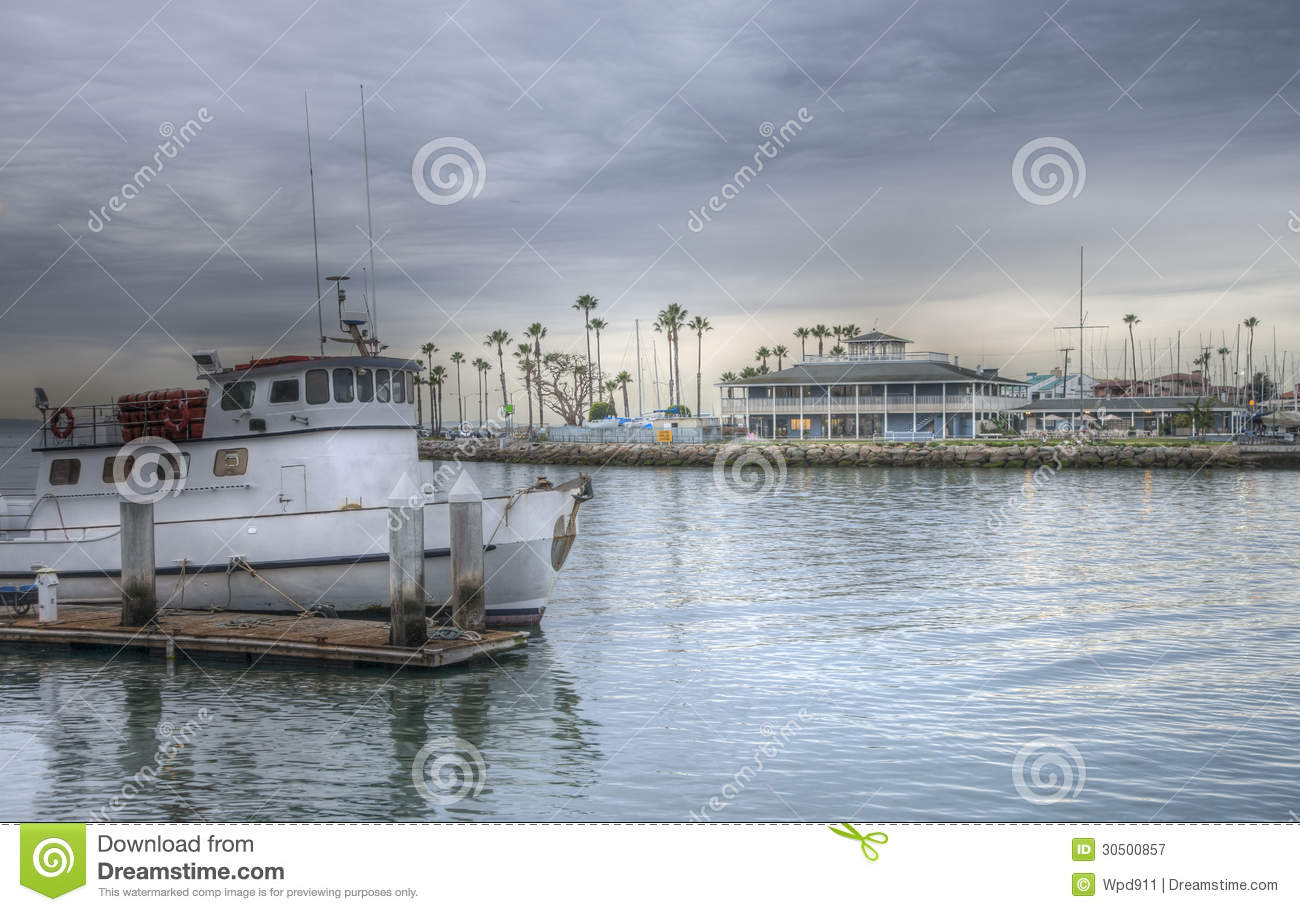 Dramatic hdr image boat harbor royalty free stock for Long beach fishing boat
