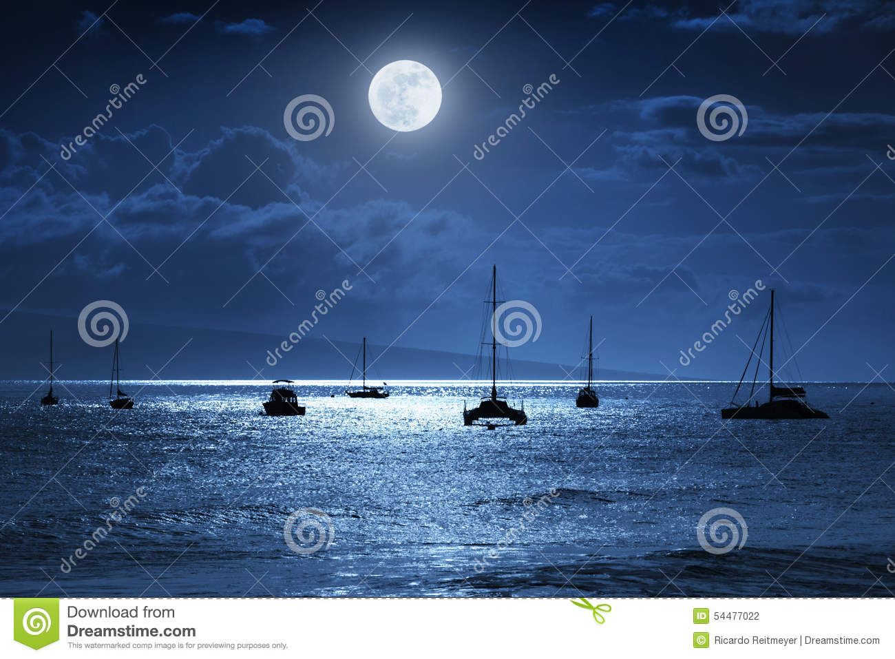 Dramatic Nighttime Ocean Scene With Beautiful Full Blue Moon in Lahaina on the island of Maui, Hawaii
