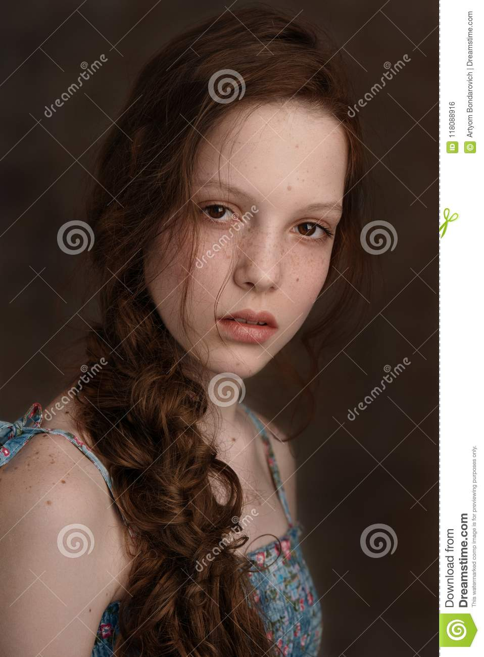 Dramatic Portrait Of A Young Cute Redhead Teenage Girl With Curly