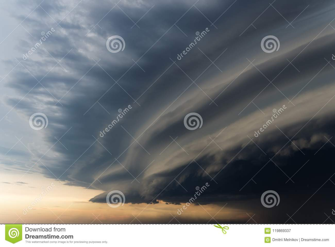 Dramatic rainy sky and dark clouds. Hurricane wind. Strong hurricane over the city. The sky is covered with black storm clouds. Sc
