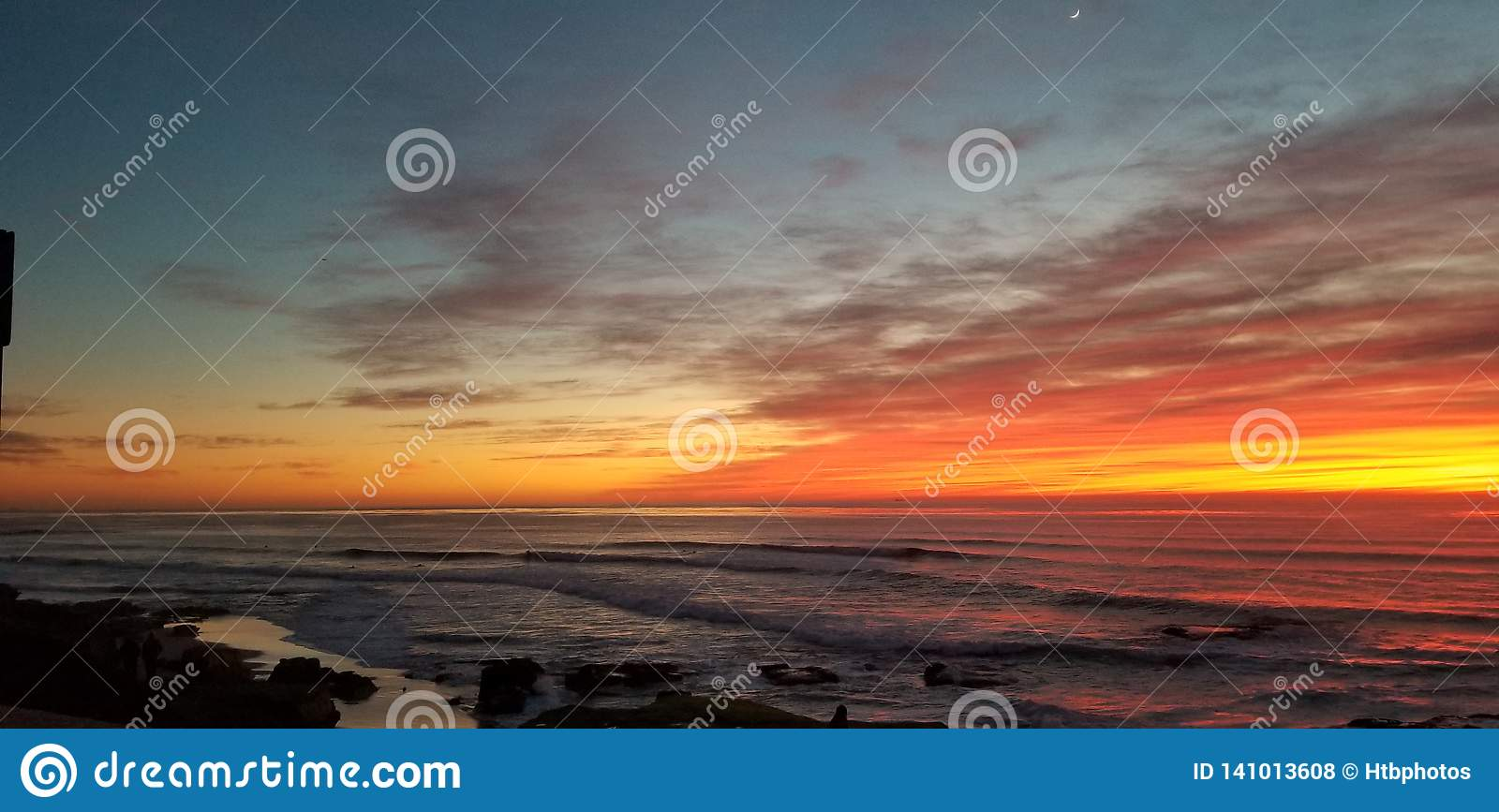 Dramatic Sunset over Pacific Ocean - Waves Crashing on the Rocks
