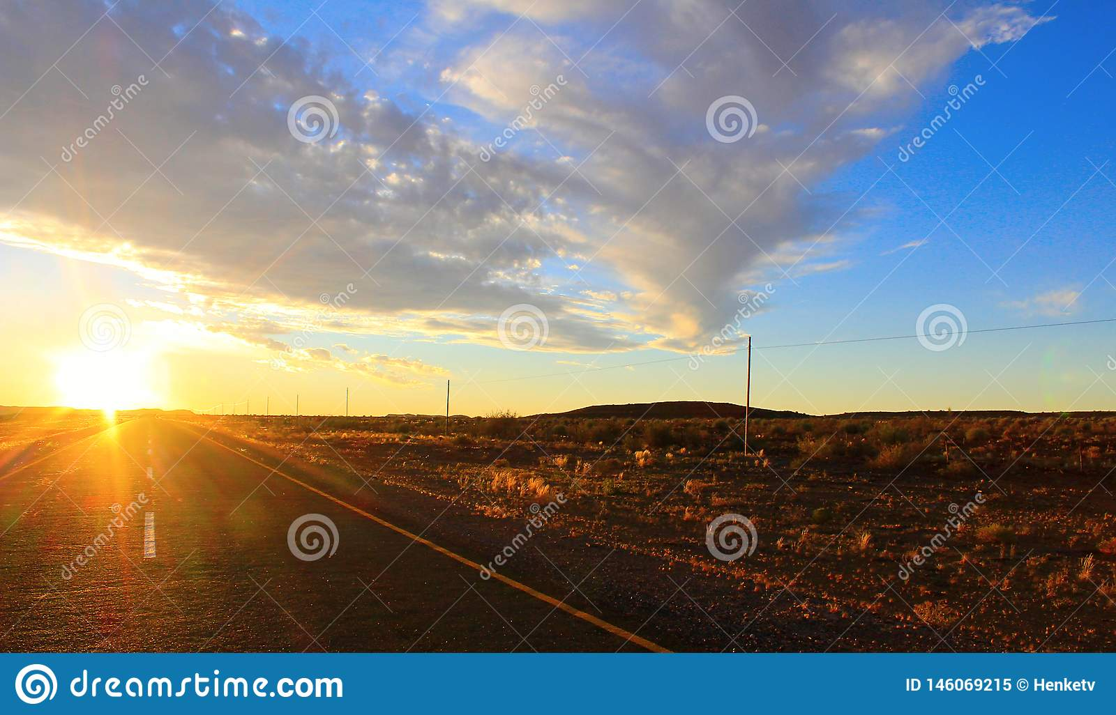 Sunset sky and road in the desert