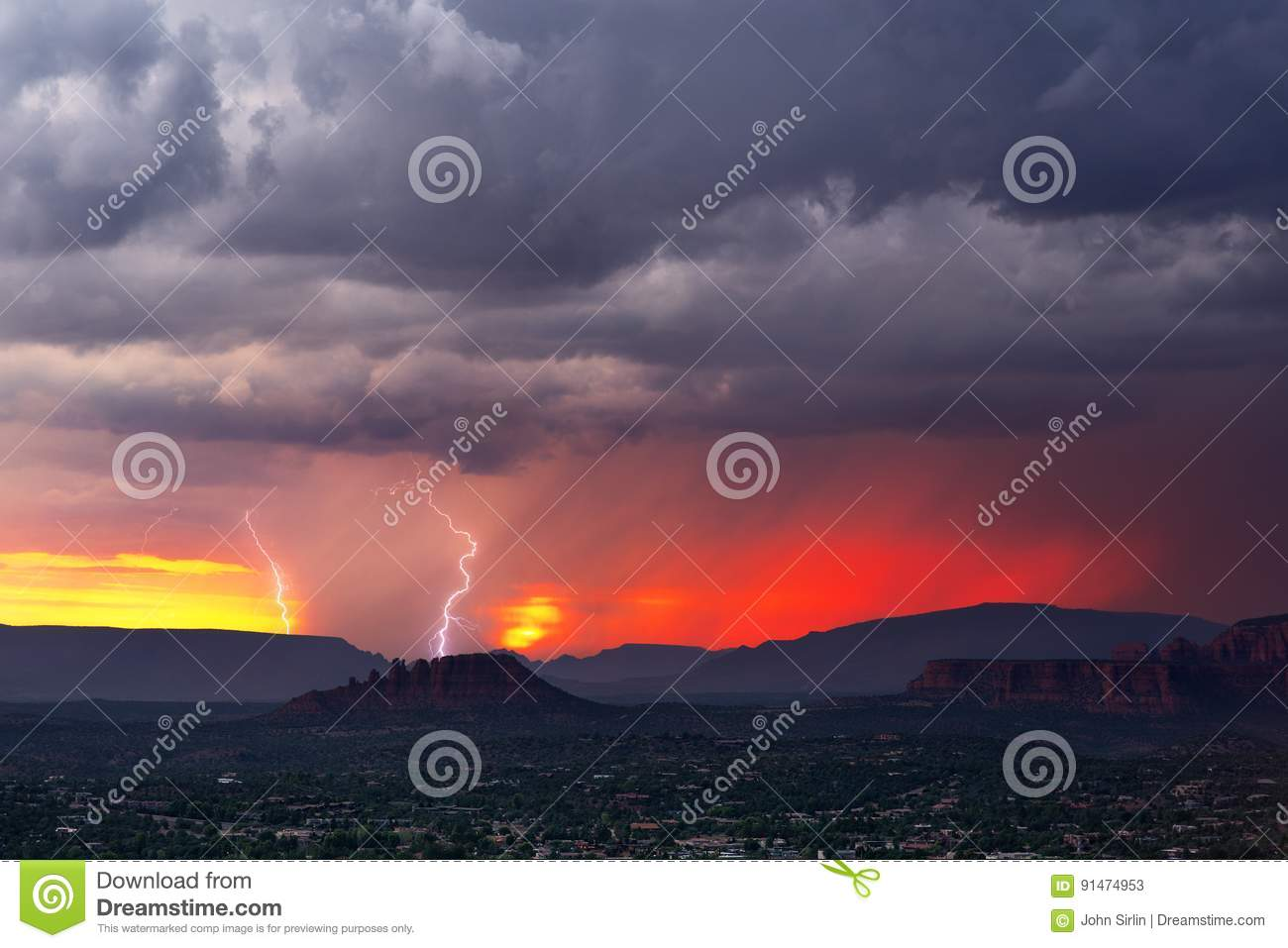 Dramatic Sunset Sky With Lightning And Storm Clouds Stock