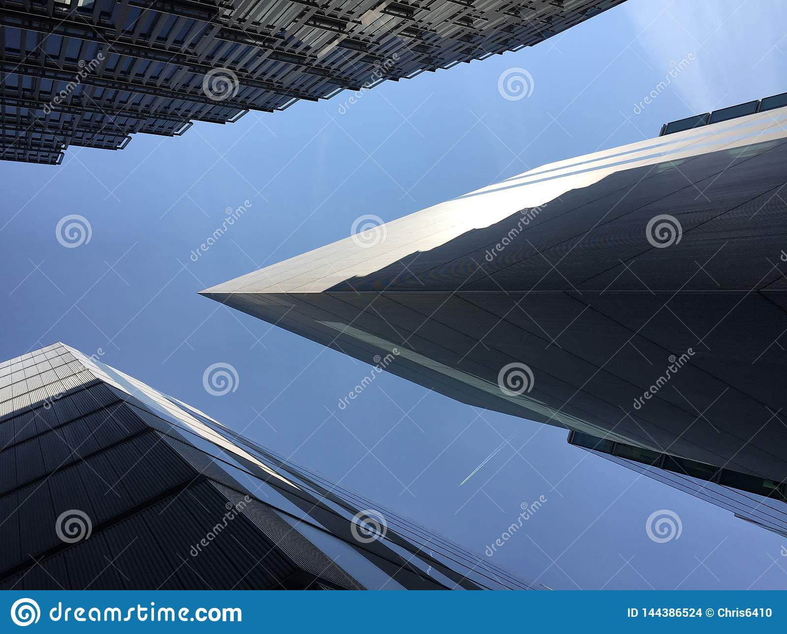 Abstract view of modern architecture with a plane passing overhead in London