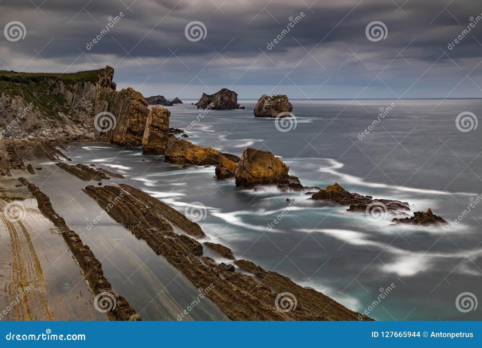 Dramatic view of Playa de la Arnia, Cantabria, Spain.