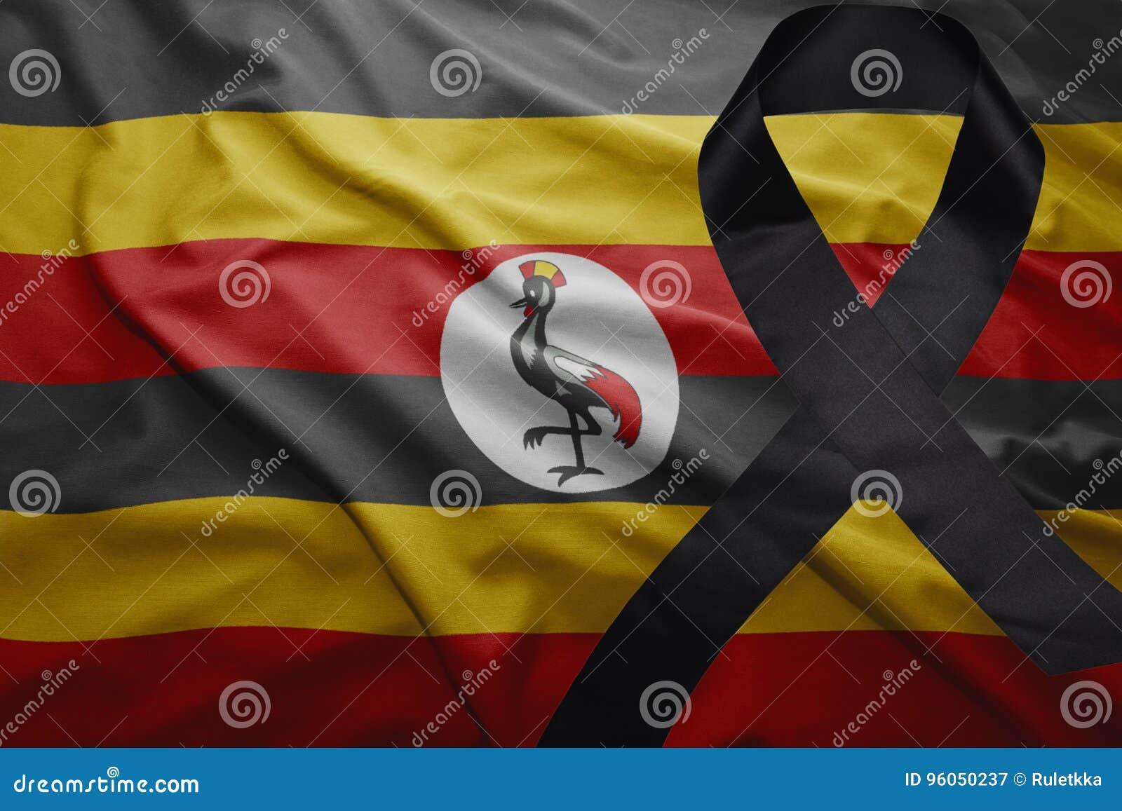 Drapeau de l Ouganda avec le ruban de deuil noir