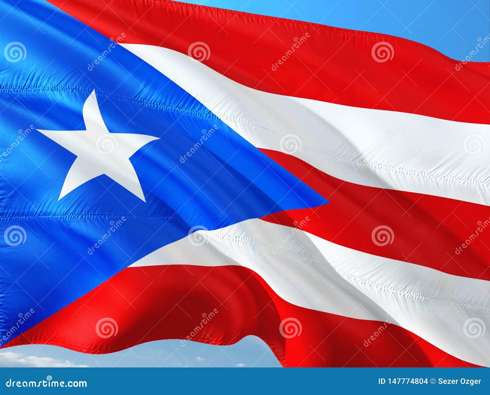 Drapeau de Puerto Rico ondulant dans le vent contre le ciel bleu profond Tissu de haute qualit?