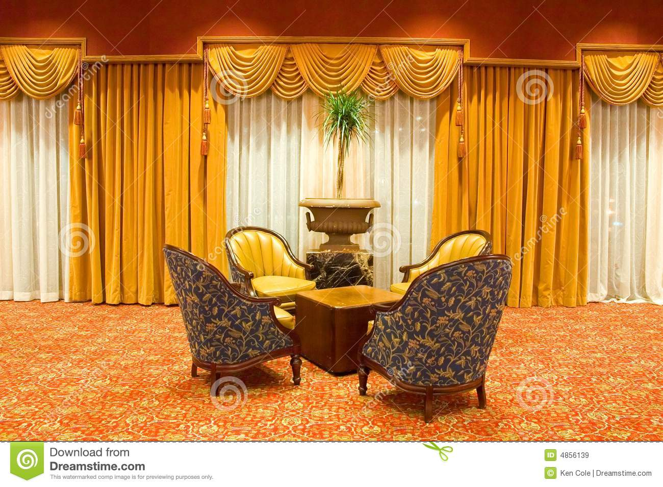 Draped curtains and chairs