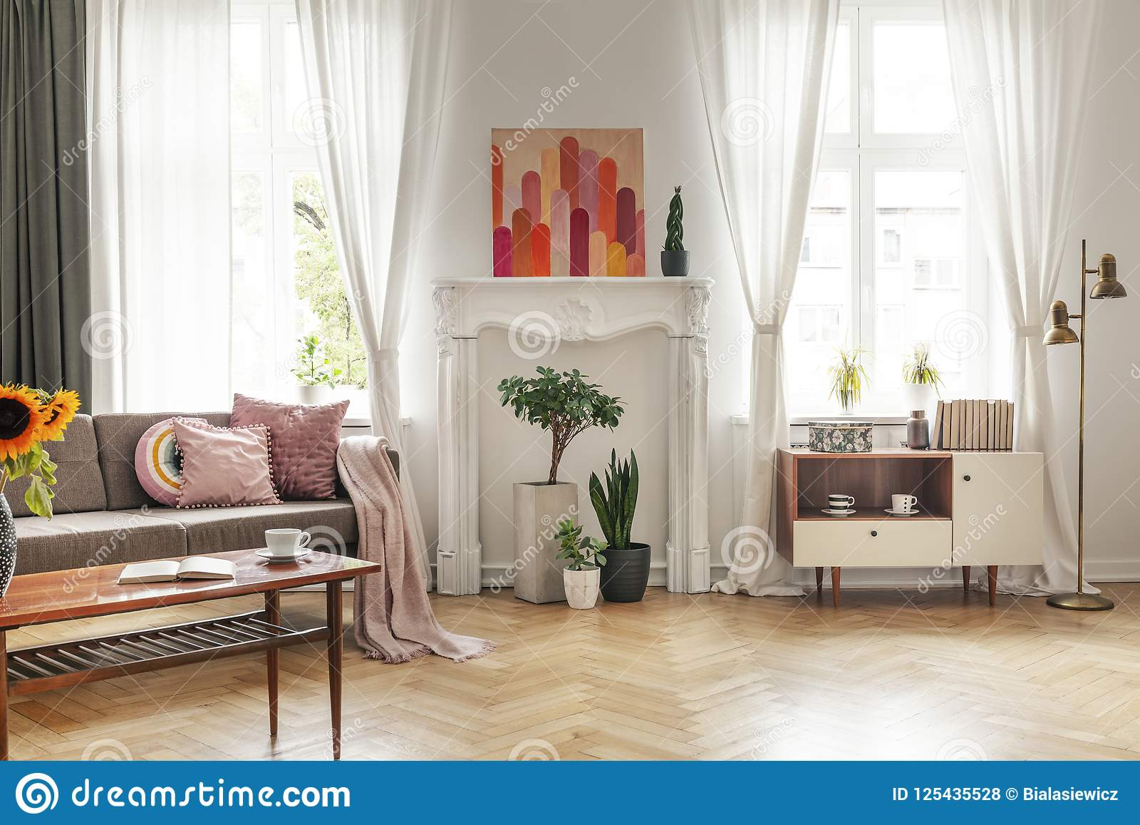 Drapes At Windows And Poster In White Living Room Interior With