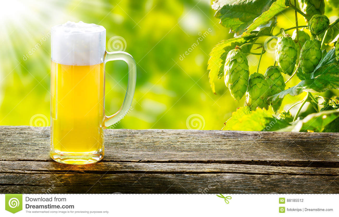 Draught beer on wooden table