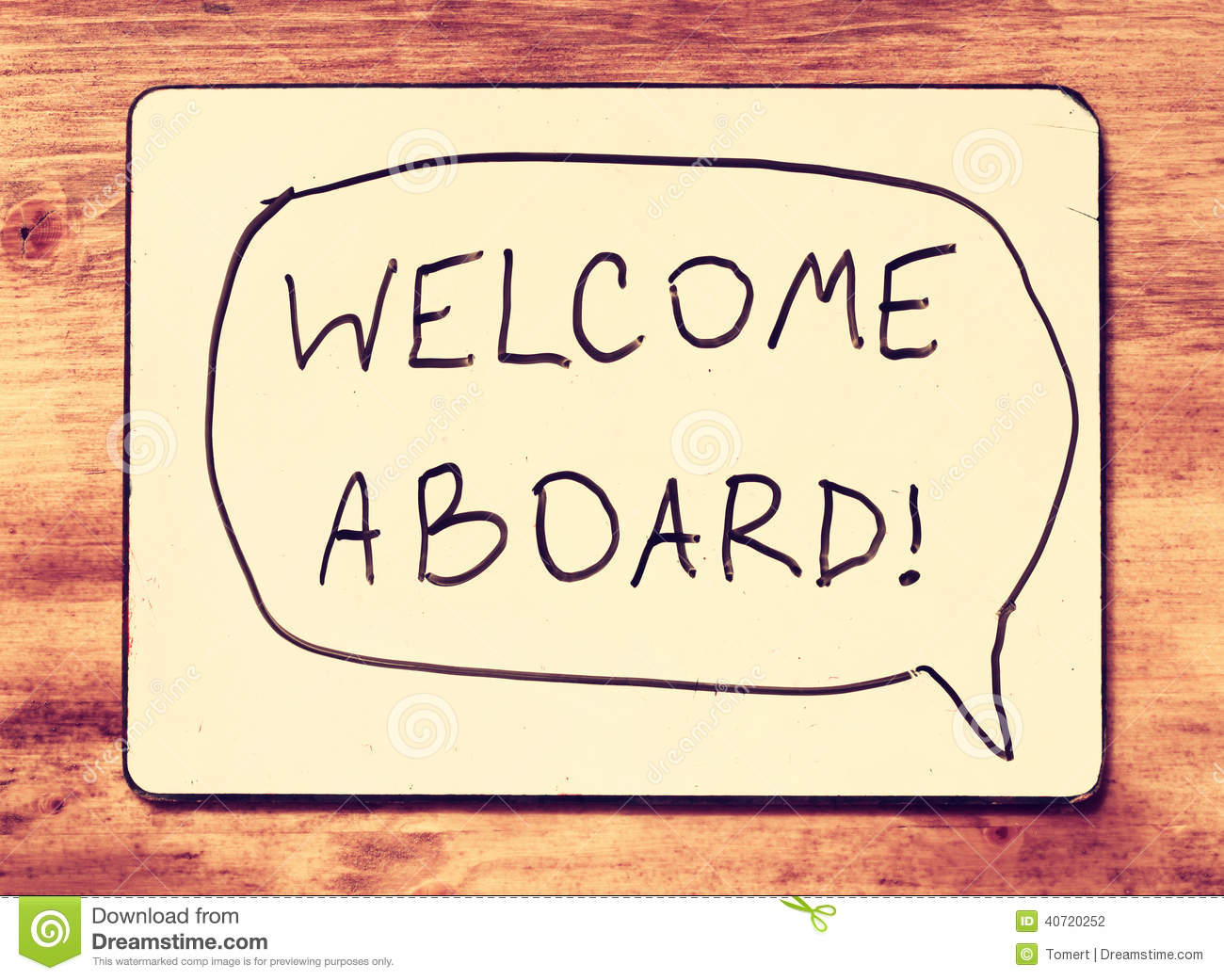 Drawing Board With The Phrase Welcome Aboard Handwritten Over Wooden
