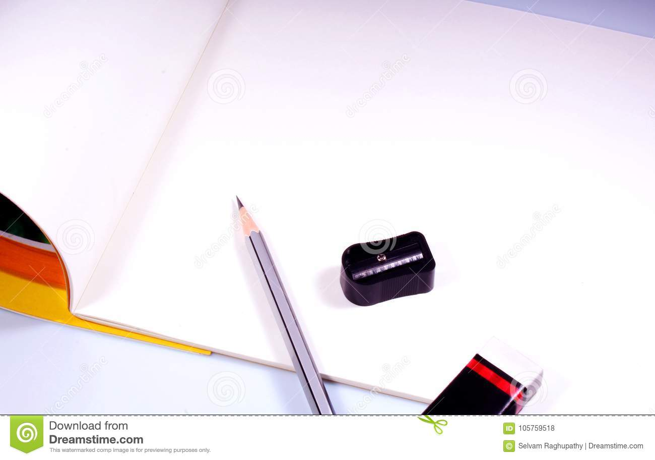 Sketch pens with plain white drawing book educational concept background photo