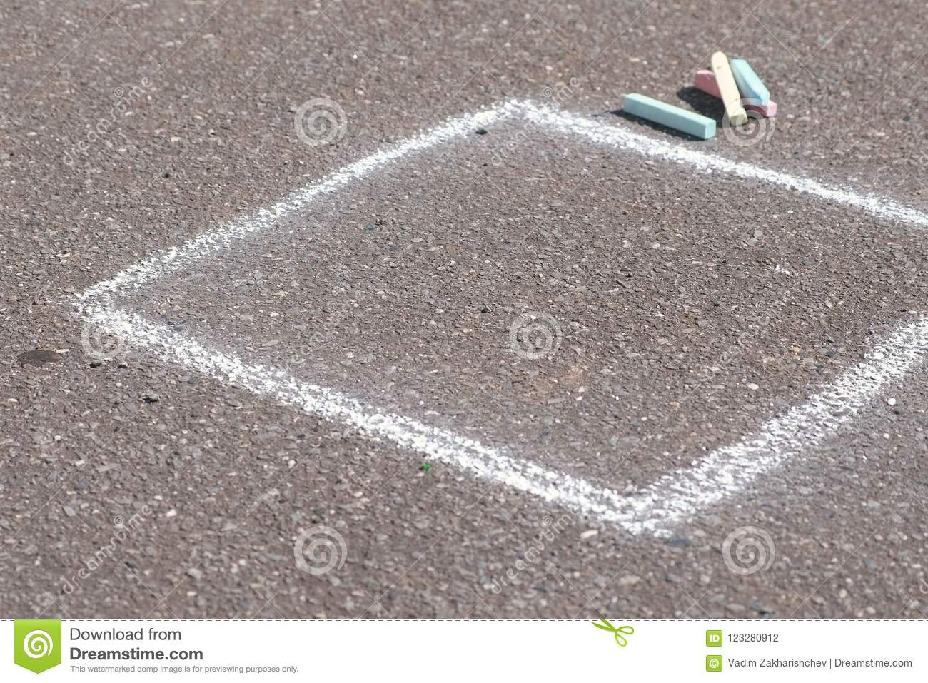 Drawing square with chalk on asphalt outdoor.