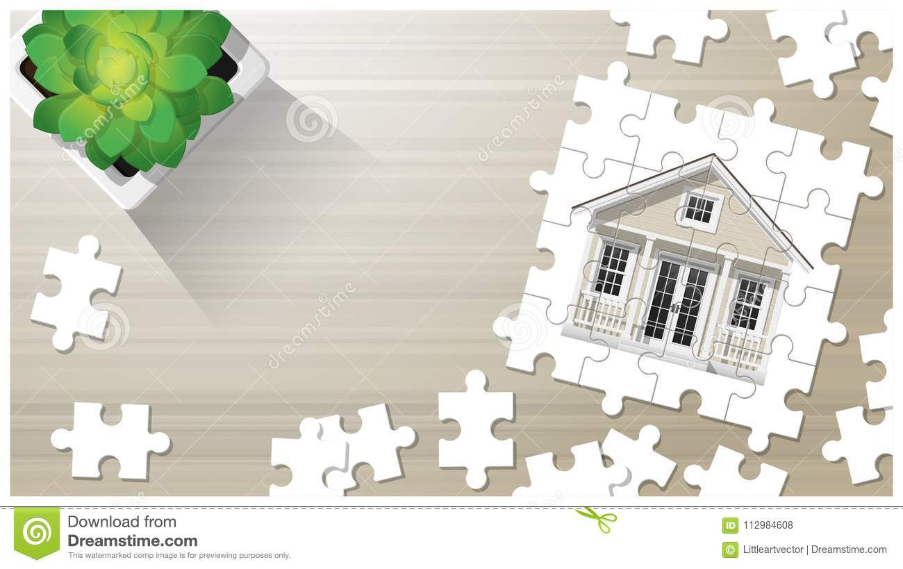 Dream house concept with puzzle house on wooden board background