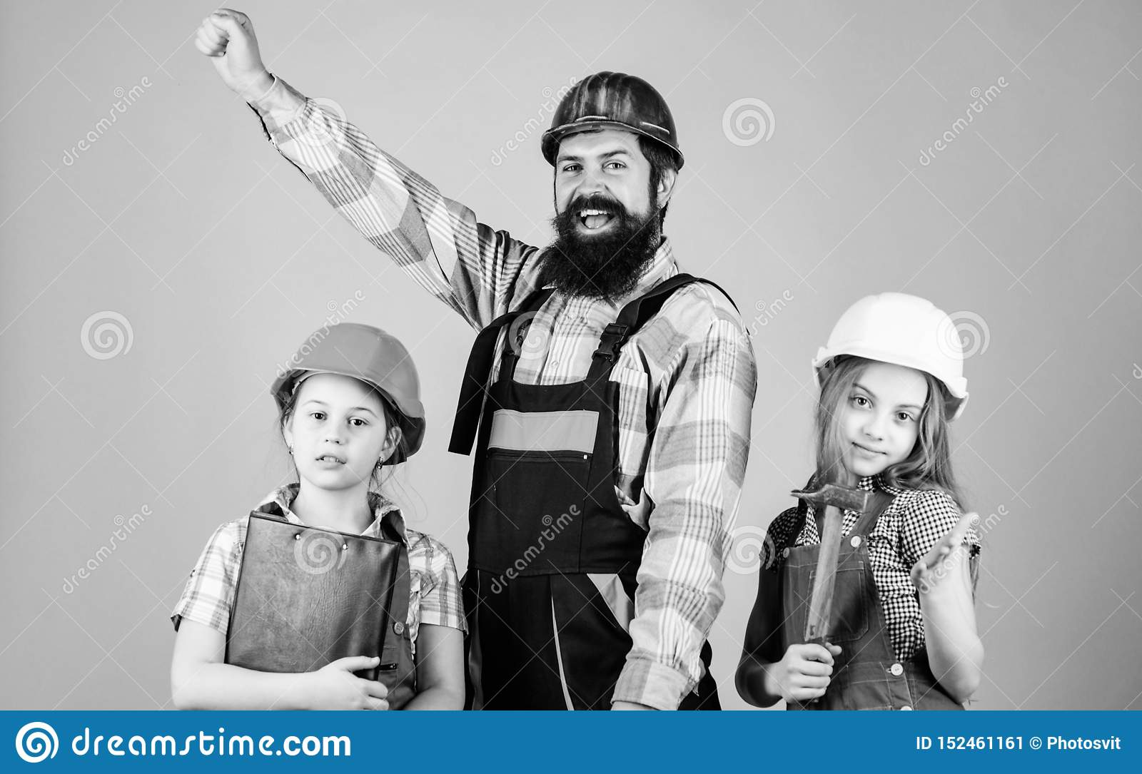 Dream team. Father builder and kids girls repair home. Teach daughter. Informal education. Fathers day. Sisters help