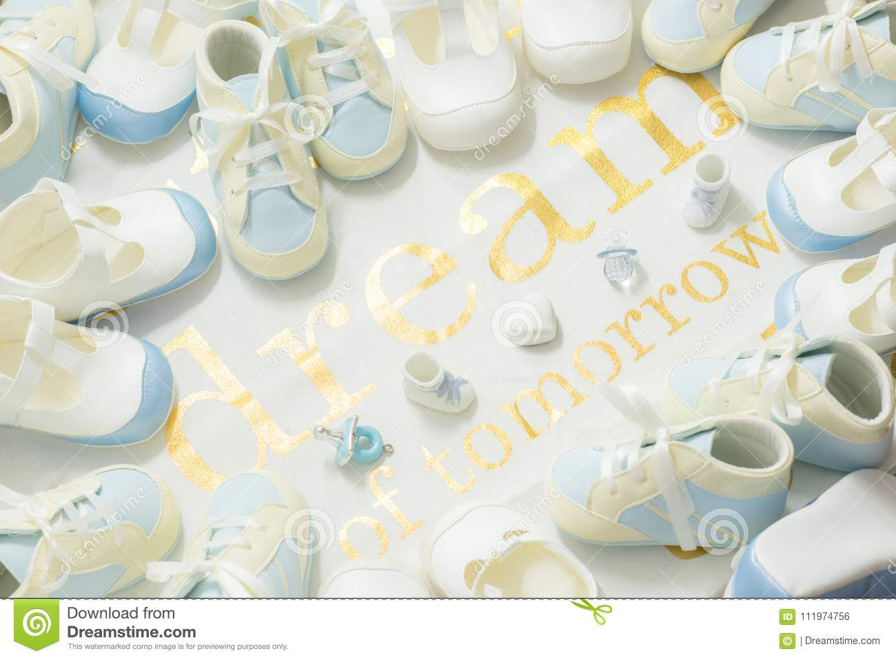 baby boy blue bootees frame on a white cloth background welcoming