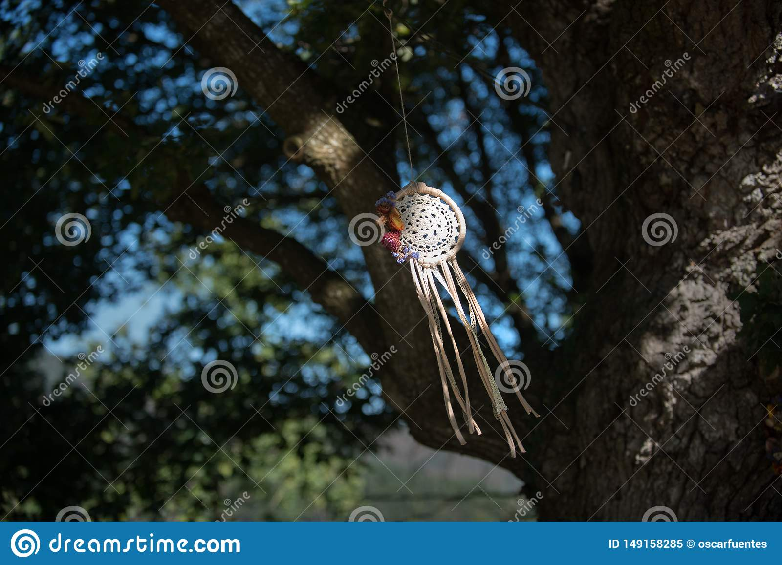 Dream Catcher with natural background in vintage style. Boho chic, ethnic amulet