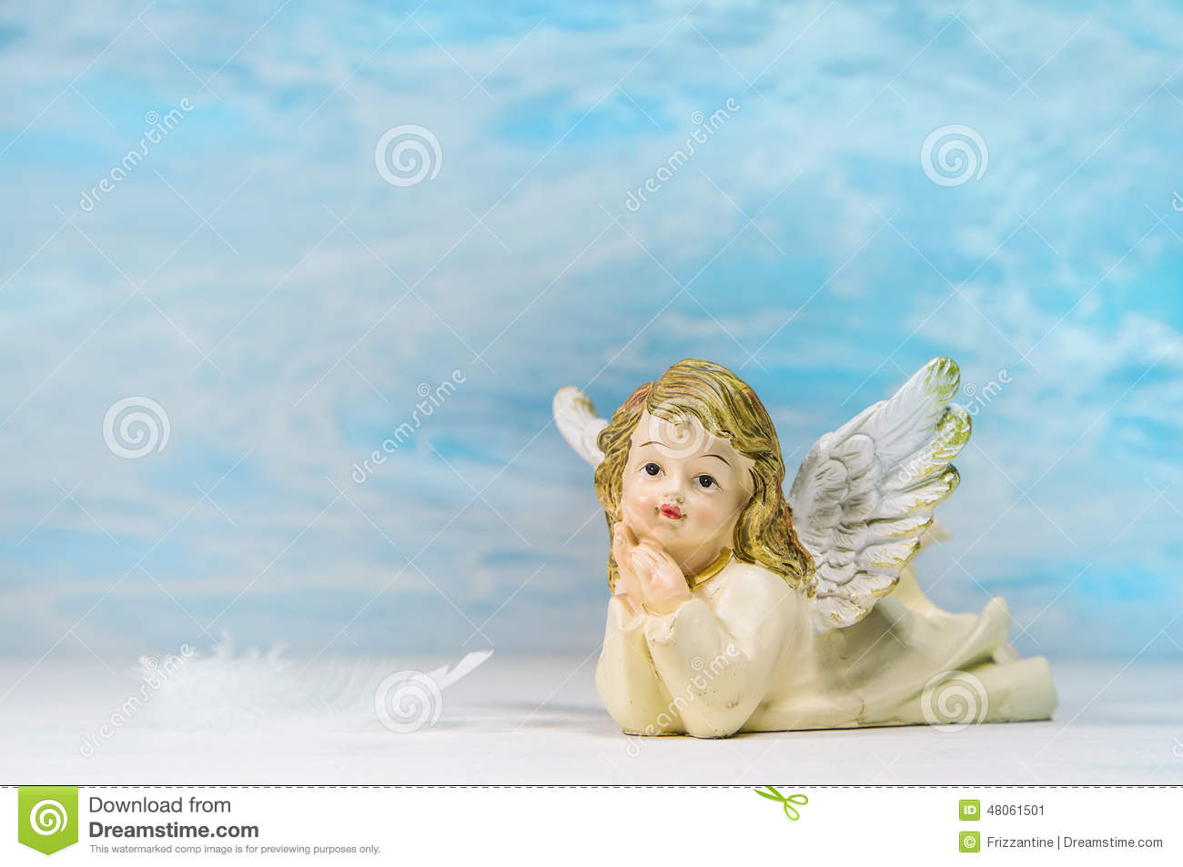 Dreaming angel on a blue background greeting card for death ch stock