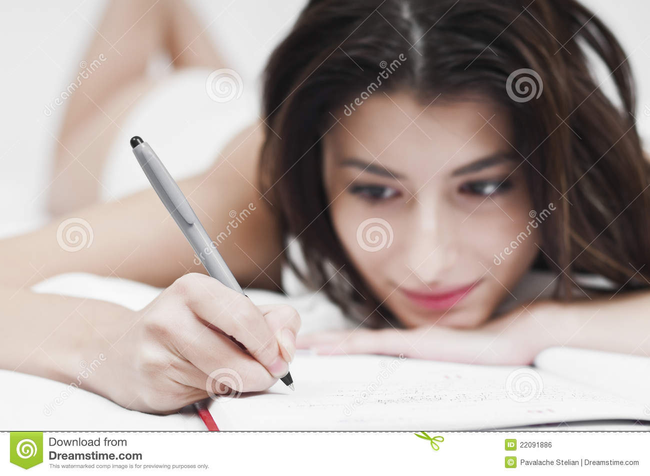 Dreaming woman writing on a notebook