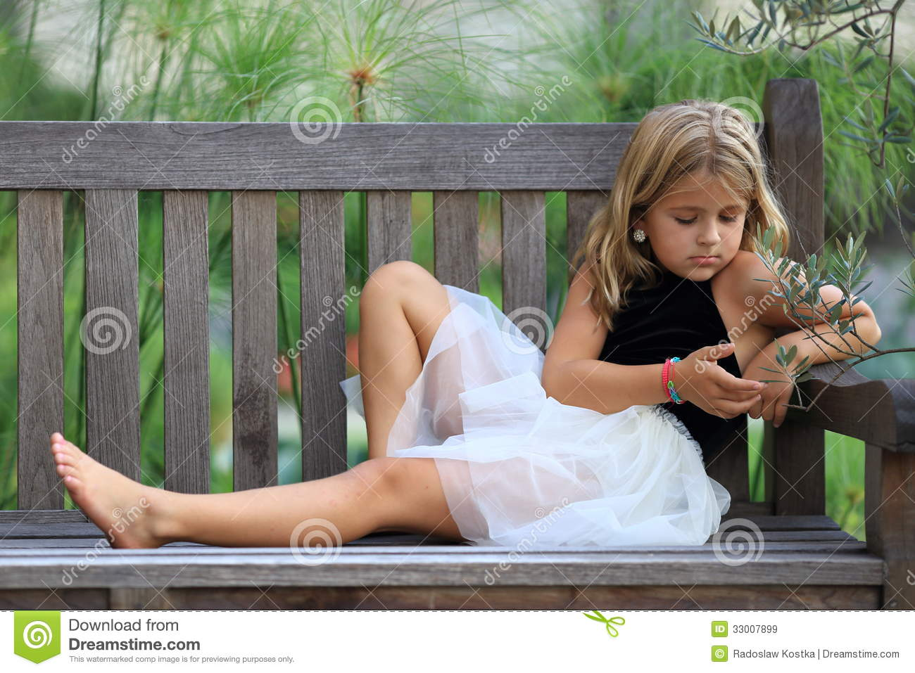 Girl Sitting Alone On Bench Dreaming stock image. ...