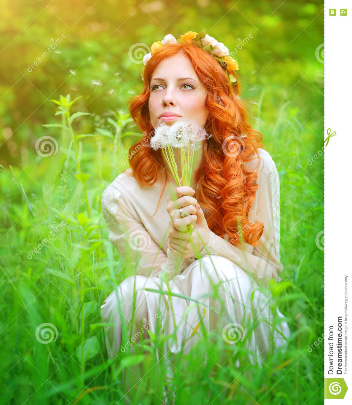 Dreamy girl with a dandelion bouquet