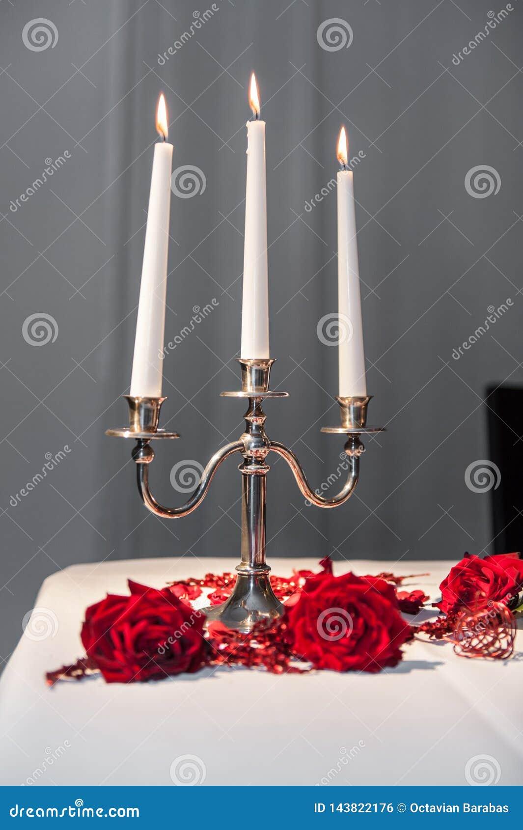 Drei Kerzen im Kerzenhalter