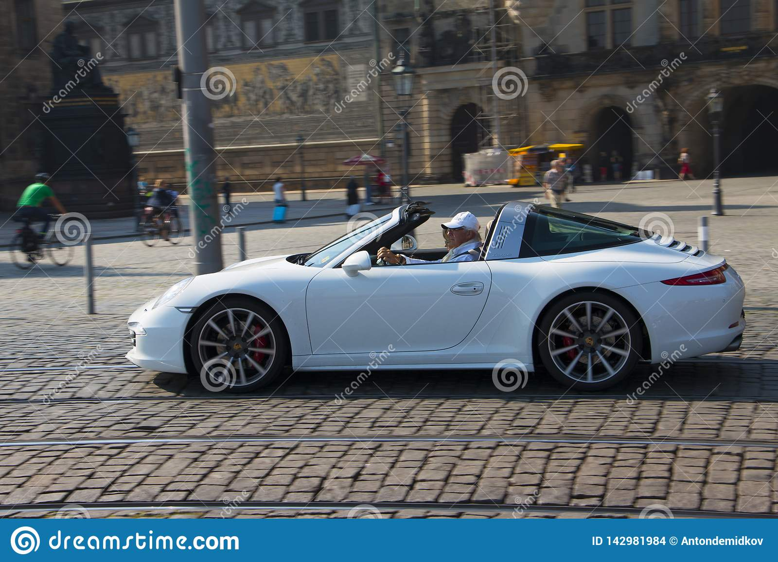 Dresden, Germany - July, 2015: Old man rides his porsche.