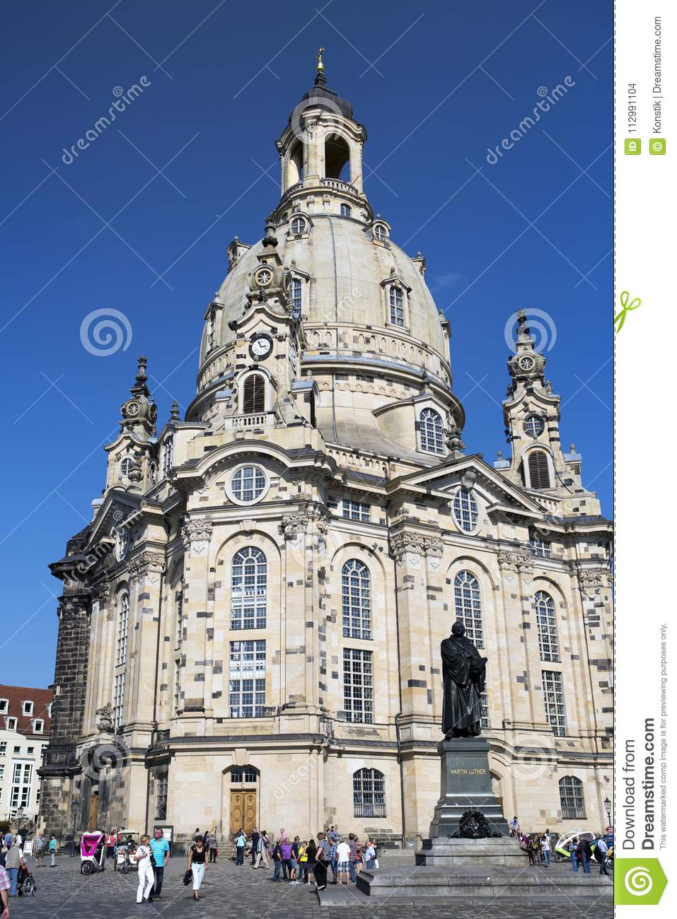 DRESDEN, GERMANY - SEPTEMBER 17, 2014: People walk in the center of Old town, near Frauenkirche Our Lady church