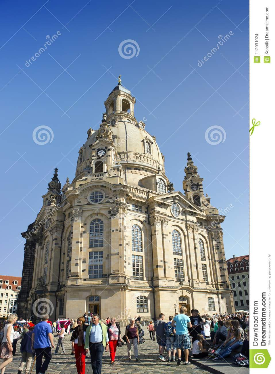 DRESDEN, GERMANY - SEPTEMBER 17: People walk on Neumarkt Square at Frauenkirche Our Lady church in the center of Old town