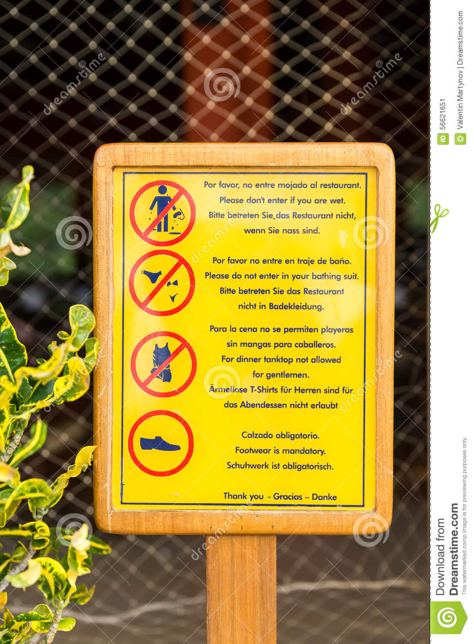 Dress Code Restricting Sign At A Restaurant Next To A Pool