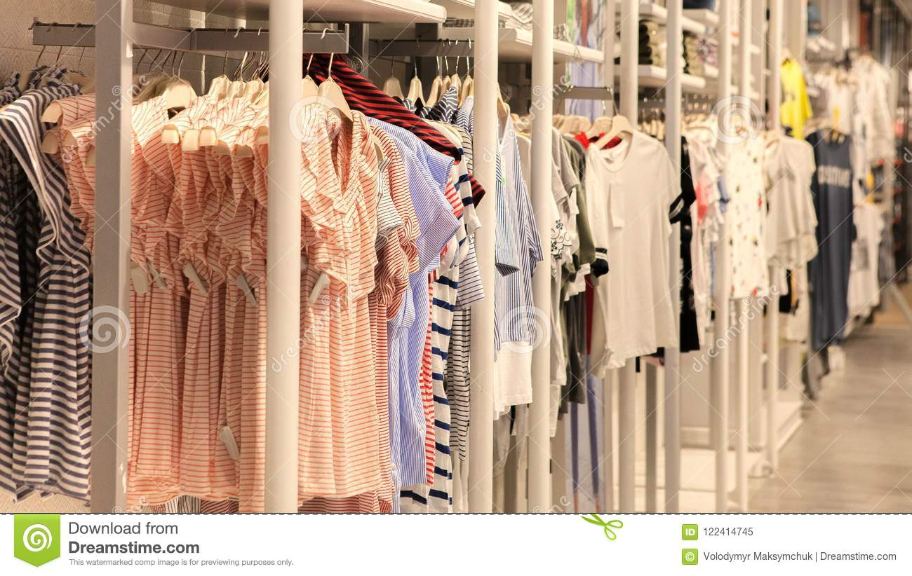 a73a27465 Dress In The Store, Fashion Clothing On Hangers At The Shop Stock ...