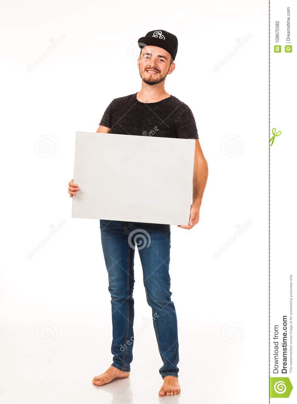 A guy with a beard posing with a white sign. Can be used for advertising, logo and business cards, contact phones, shares, etc.