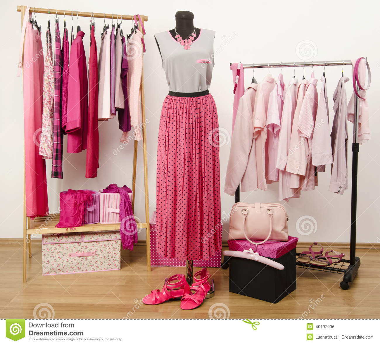 Dressing Closet With Pink Clothes Arranged On Hangers And An Outfit On A Mannequin Stock Photo
