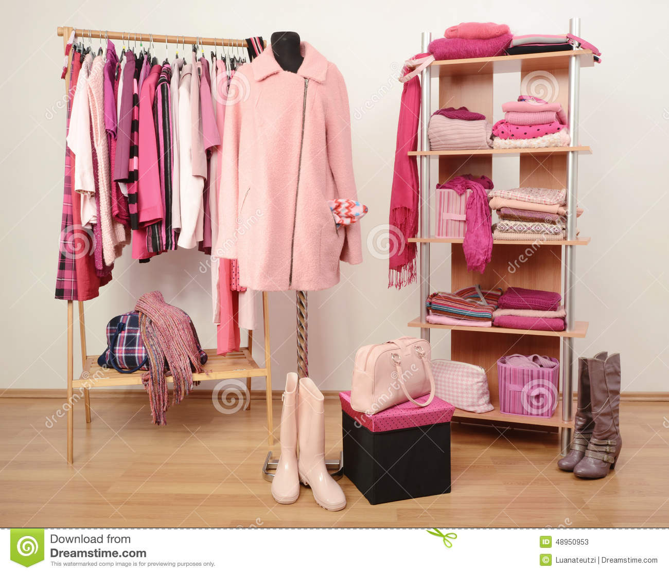 Nice Dressing Closet With Pink Clothes Arranged On Hangers And Shelf, A Coat On  A Mannequin.